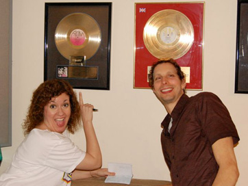 Kathy Zimmer And Chris Benelli Admiring The Gold Records.