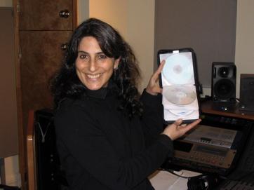 Liz Queler — Singer — Writer Shows Off Her CDs.